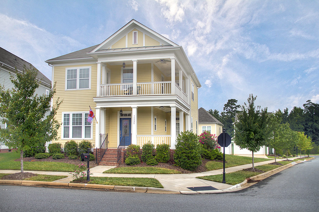 double porch home for sale in monteith park lake norman